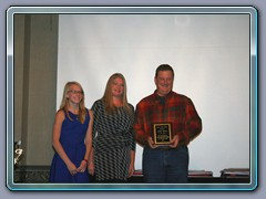 Amy & Tori Mills giving Mr. Andy Keene the Gary Mills Award