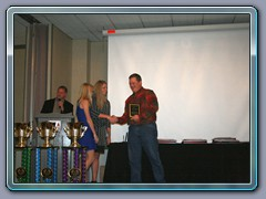 Amy Mills giving out the Gary Mills Award, to Mr. Andy Keene