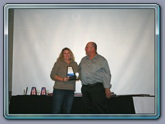 Mr. Grease Monkey of The Year, George Abshire. Michele accepting his award.